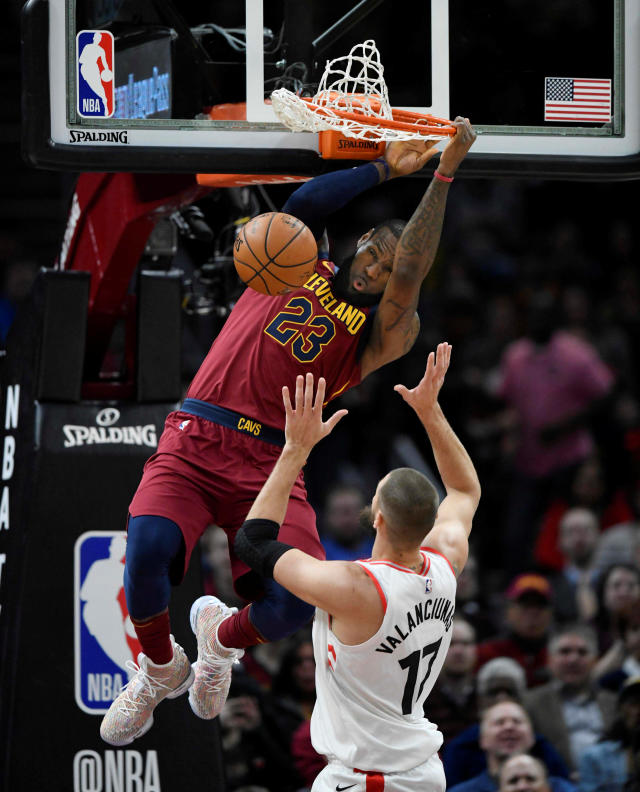 Mar 21, 2018; Cleveland, OH, USA; Cleveland Cavaliers forward LeBron James (23) dunks beside Toronto Raptors center Jonas Valanciunas (17) in the first quarter at Quicken Loans Arena. Mandatory Credit: David Richard-USA TODAY Sports TPX IMAGES OF THE DAY