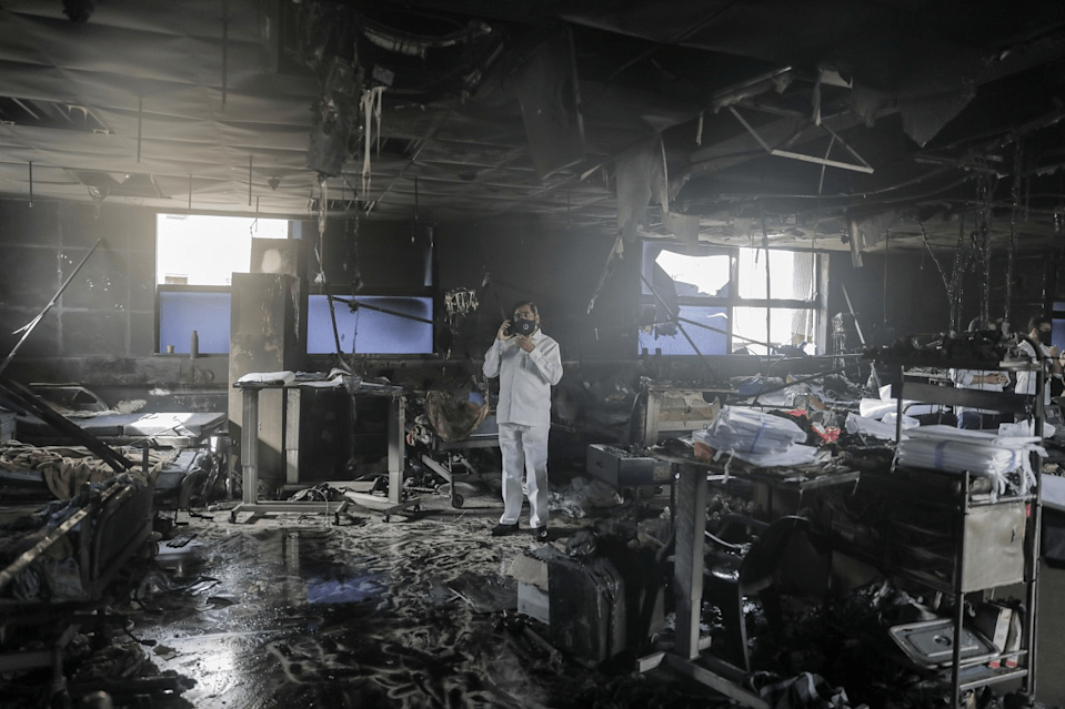 Maharashtra state Minister Eknath Shinde at the site of the fire at a Covid-19 hospital, where at least 13 patients died, in Virar