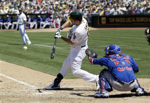 Oakland Athletics' Seth Smith singles against the Chicago Cubs during the seventh inning of a baseball game Thursday, July 4, 2013 in Oakland, Calif. (AP Photo/Marcio Jose Sanchez)
