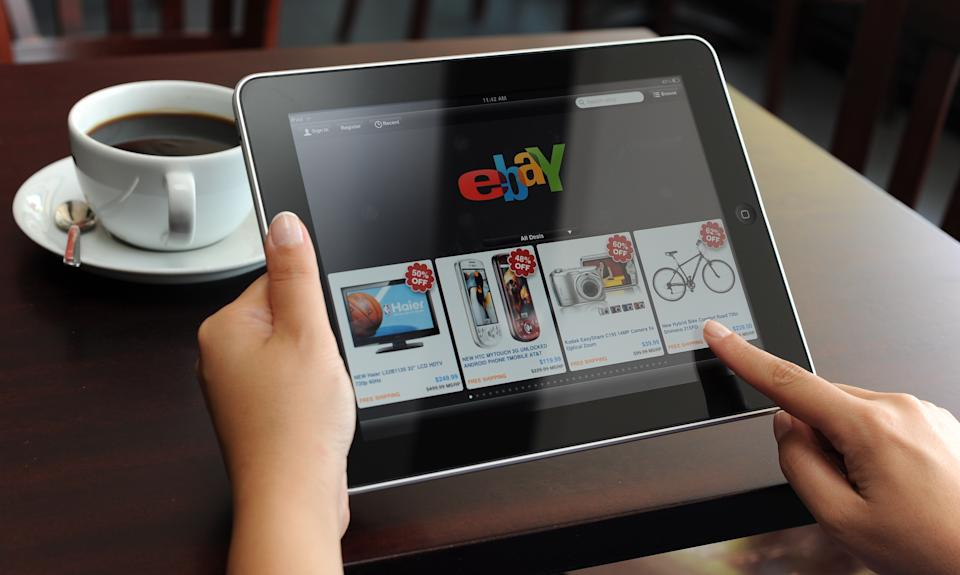 Astanbul, Turkey - July, 28: Hand holding iPad displaying eBay application. eBay is the most visited an online auction and shopping website, owned by eBay Inc. The iPad is produced by Apple Computer, Inc.