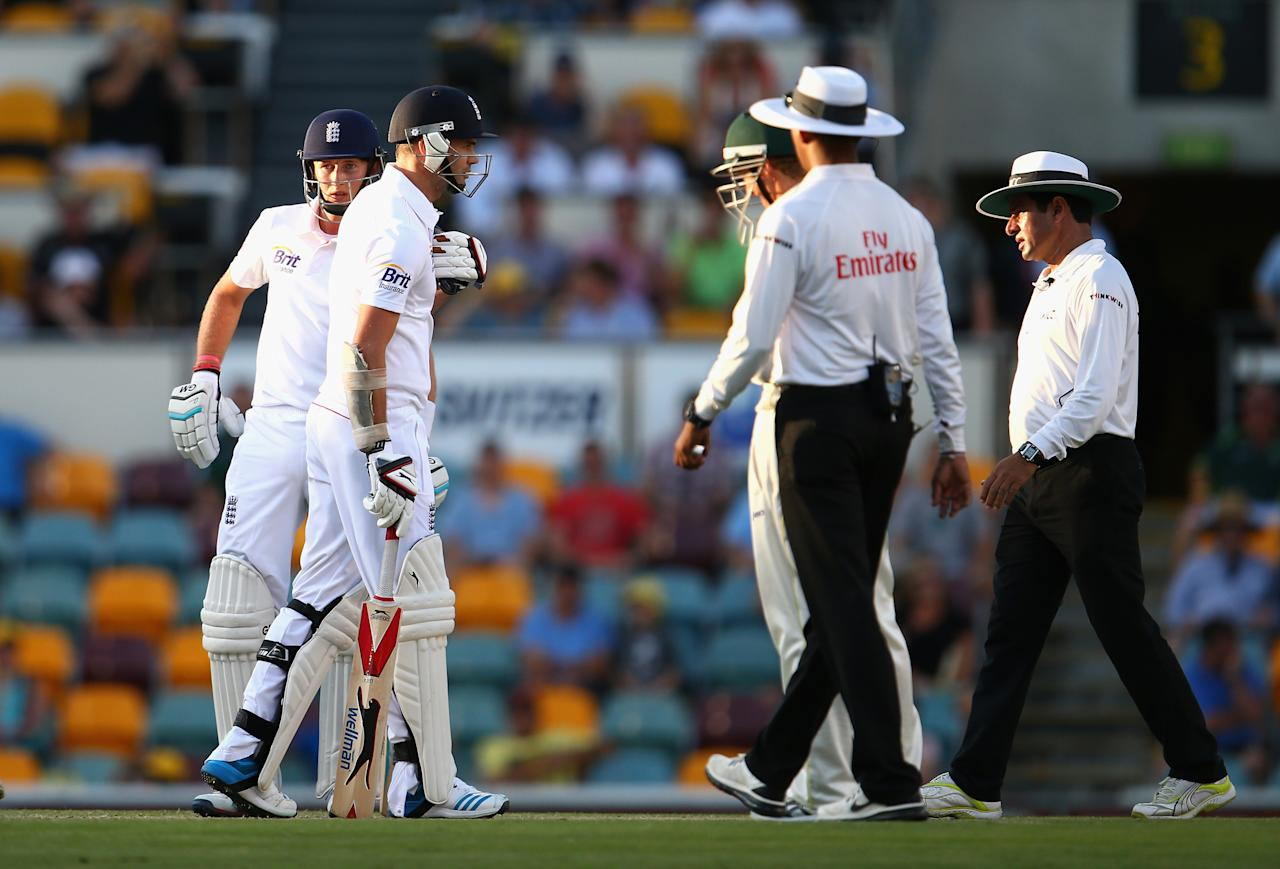 BRISBANE, AUSTRALIA - NOVEMBER 24:  George Bailey of Australia and James Anderson of England exchange words during day four of the First Ashes Test match between Australia and England at The Gabba on November 24, 2013 in Brisbane, Australia.  (Photo by Ryan Pierse/Getty Images)