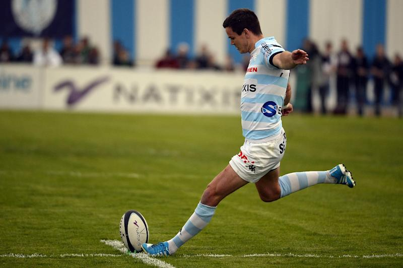 Racing-Metro's Irish fly-half Jonathan Sexton kicks the ball to score a penalty during the French Top 14 rugby union match between Racing Metro 92 and Biarritz Olympique on April 12, 2014, at the Yves du Manoir stadium in Colombes