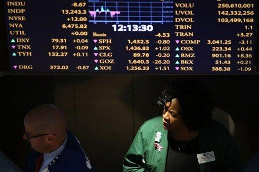 Traders work on the floor of the New York Stock Exchange (NYSE) in New York City on December 20, 2012