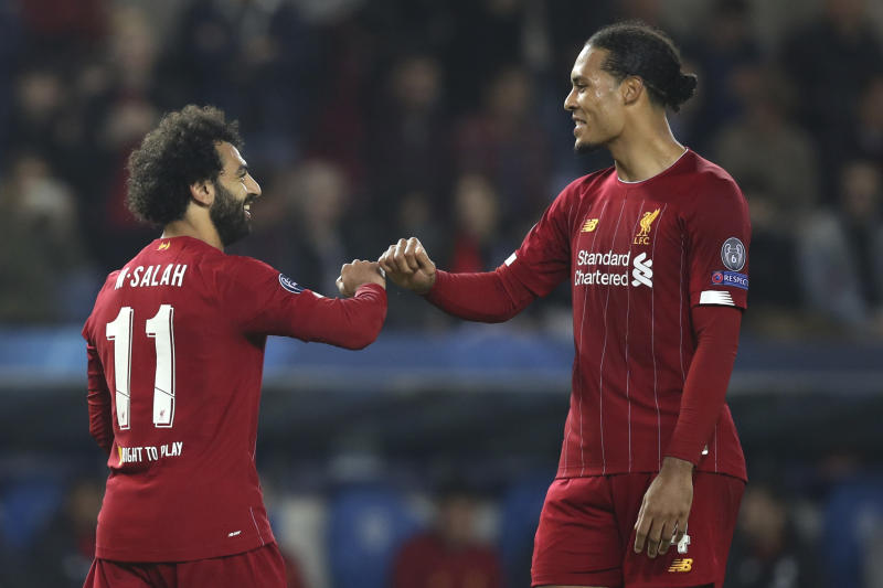 Mohamed Salah (left), Virgil van Dijk and Liverpool remain every bit as dangerous as they were last season. (AP Photo/Francisco Seco)