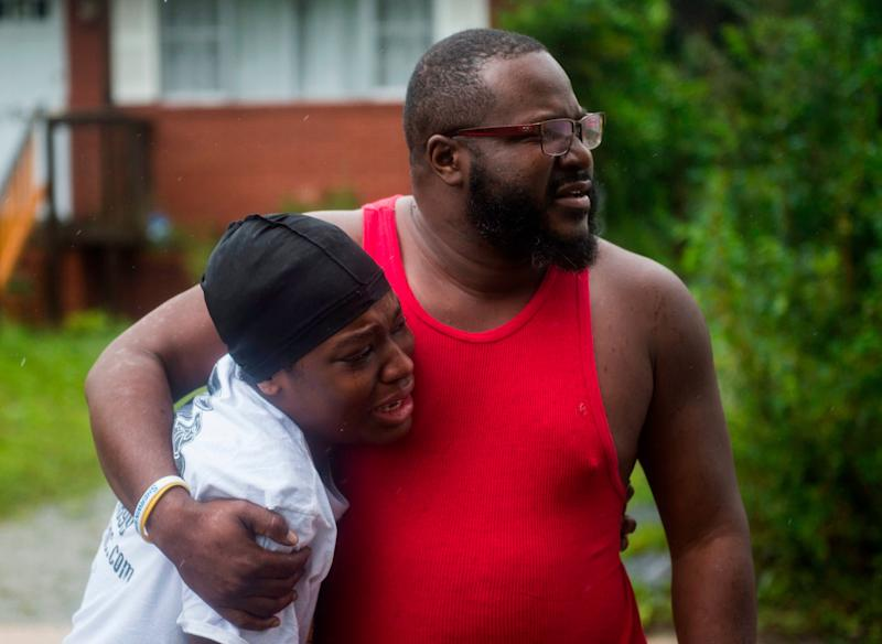 A father and daughter learn that friends were injured and later died when a tree fell on their house during landfall of Hurricane Florence in Wilmington, North Carolina on Friday.