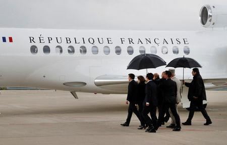 French President's personal Chief of military staff, Admiral Bernard Rogel, French Foreign Minister Jean-Yves Le Drian, French President Emmanuel Macron, French Defence Minister Florence Parly and South Korean ambassador to France, Jong-moon Choi, arrive to greet hostages who were freed by special forces in Burkina Faso after their plane landed at the Villacoublay airport, in Velizy-Villacoublay, France May 11, 2019. Francois Guillot/Pool via REUTERS