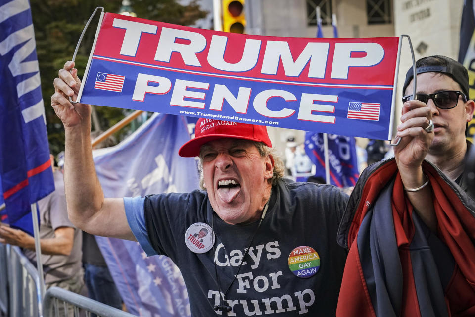 An angry supporter of President Donald Trump shouts at crowds of celebrating demonstrators after the 2020 presidential election is called for President-elect Joe Biden, Saturday, Nov. 7, 2020, in Philadelphia. (AP Photo/John Minchillo)