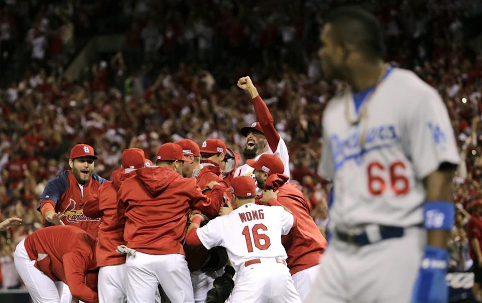 St. Louis Cardinals players celebrate after their 3-2 win over Los Angeles Dodgers in Game 4 of the 2014 NLDS.