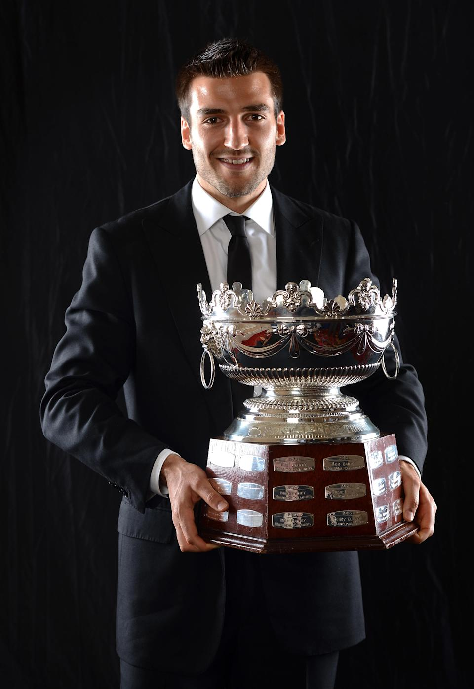 LAS VEGAS, NV - JUNE 20: Patrice Bergeron of the Boston Bruins poses after winning the Frank Selke Trophy during the 2012 NHL Awards at the Encore Theater at the Wynn Las Vegas on June 20, 2012 in Las Vegas, Nevada. (Photo by Harry How/Getty Images)