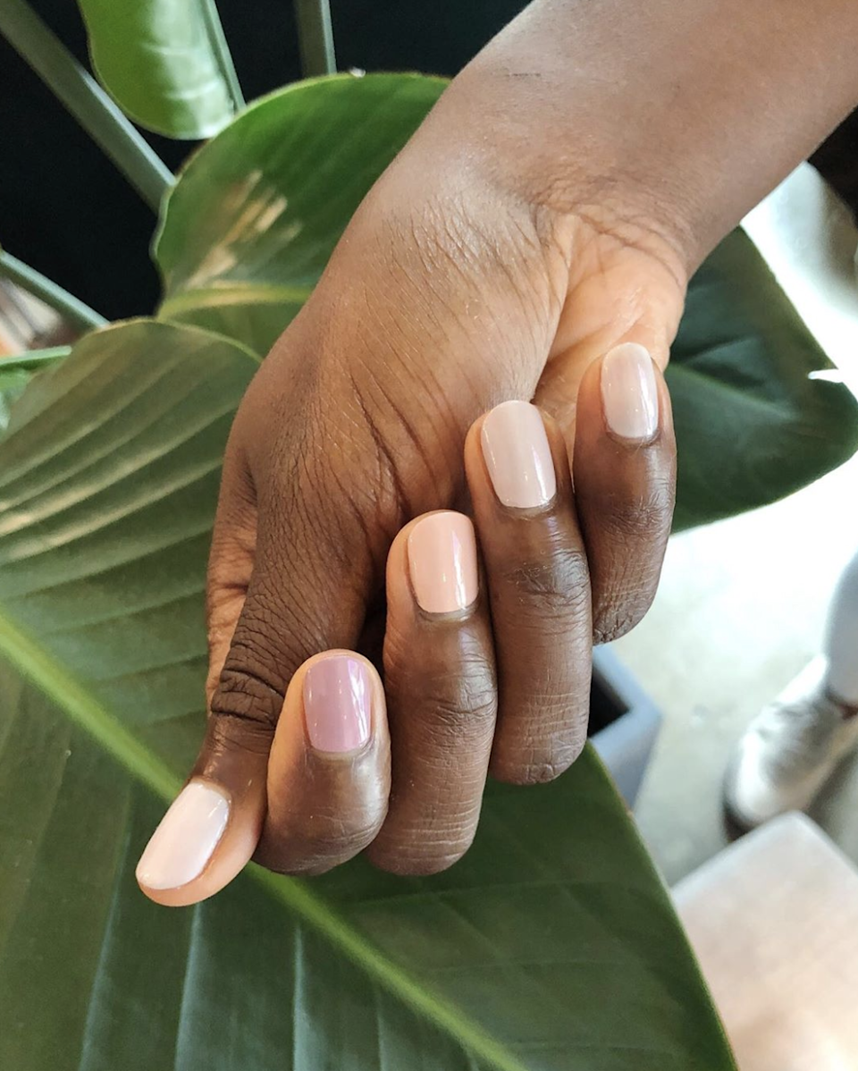 """Gradient nails are one of our favorite ways to create an eye-catching effect with minimal effort. At San Francisco's <a href=""""https://www.instagram.com/p/B0KOtZbhJWT/"""" rel=""""nofollow noopener"""" target=""""_blank"""" data-ylk=""""slk:The Nail Hall"""" class=""""link rapid-noclick-resp"""">The Nail Hall</a>, mismatched manis are frequently requested in every shade of the salon's nontoxic polishes. Right now dreamier, muted shades are winning. """"Gradient nails in soft shades of pink and nude are popular,"""" says owner Jen Hall."""
