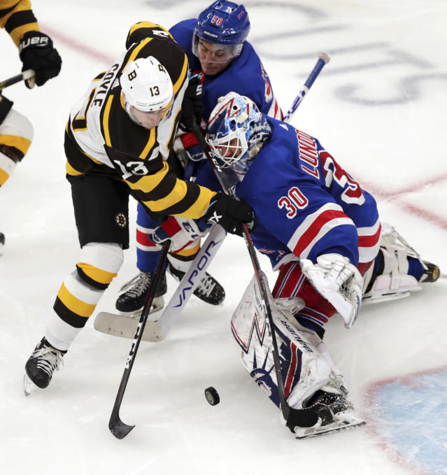 New York Rangers goaltender Henrik Lundqvist (30) makes a save on a shot by Boston Bruins center Charlie Coyle (13) during the third period of an NHL hockey game in Boston, Wednesday, March 27, 2019. At center is Rangers defenseman John Gilmour (58). (AP Photo/Charles Krupa)