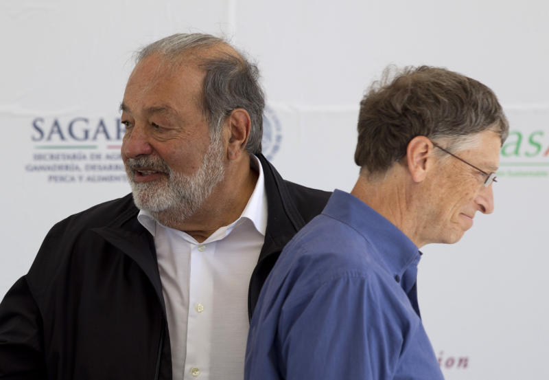 Microsoft Chairman Bill Gates, right, and Mexican telecommunications tycoon Carlos Slim attend the inauguration of a new research center at the International Center for Improvement of Corn and Wheat (CIMMYT) in Texcoco, Mexico, Wednesday, Feb. 13, 2013. Gates and Slim teamed up to to fund the seed breeding research complex, which the CIMMYT says aims to sustainably increase the productivity of maize and wheat systems to ensure global food security and reduce poverty. (AP Photo/Eduardo Verdugo)