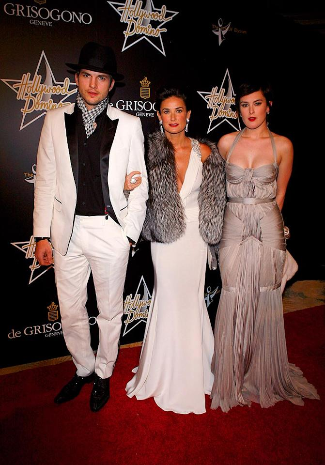 "Ashton Kutcher, Demi Moore, and Demi's daughter, Rumer Willis, walk the red carpet at the 1st Hollywood Domino Tournament hosted by De Grisogono at the Beverly Hills Hotel. While the ladies channeled old Hollywood glamour, Ashton opted to dress like a domino. Jean Baptiste Lacroix/<a href=""http://www.wireimage.com"" target=""new"">WireImage.com</a> - February 21, 2008"