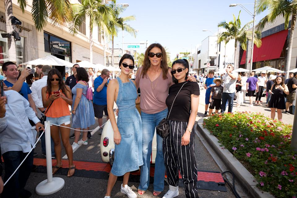 BEVERLY HILLS, CA - JUNE 18:  (L-R) Kendall Jenner, Caitlyn Jenner and Kylie Jenner pose for a photo as Caitly Jenner displays her Austin-Healey Sprite at the Rodeo Drive Concours d'Elegance  on June 18, 2017 in Beverly Hills, California.  (Photo by Earl Gibson III/Getty Images)