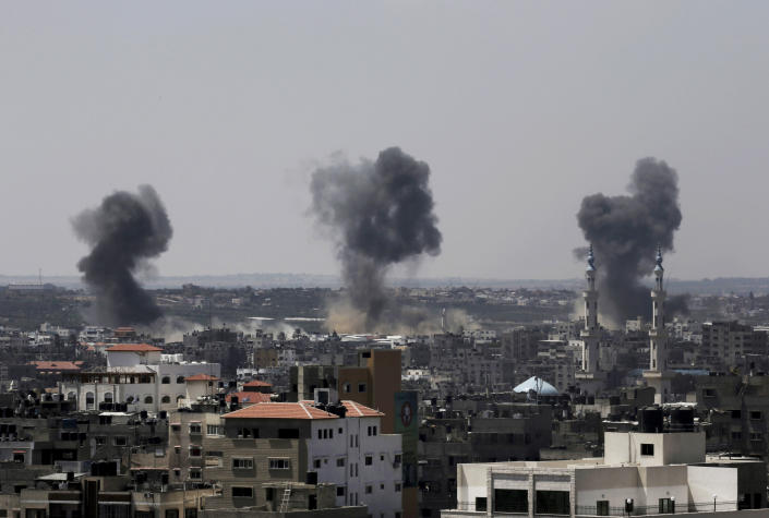 FILE - In this July 16, 2014 file photo, smoke rises after Israeli missile strikes hit the northern Gaza Strip. Israel said Thursday, April 8, 2021, it will formally reject the International Criminal Court's decision to launch a probe into potential war crimes against the Palestinians. The court is expected to look at possible war crimes committed by Israelis forces and Palestinian militants during and after the 2014 Gaza war, as well as Israel's settlements in the West Bank and east Jerusalem. (AP Photo/Adel Hana, File)
