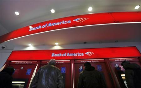 Customers use ATMs at a Bank of America banking center in New York's financial district