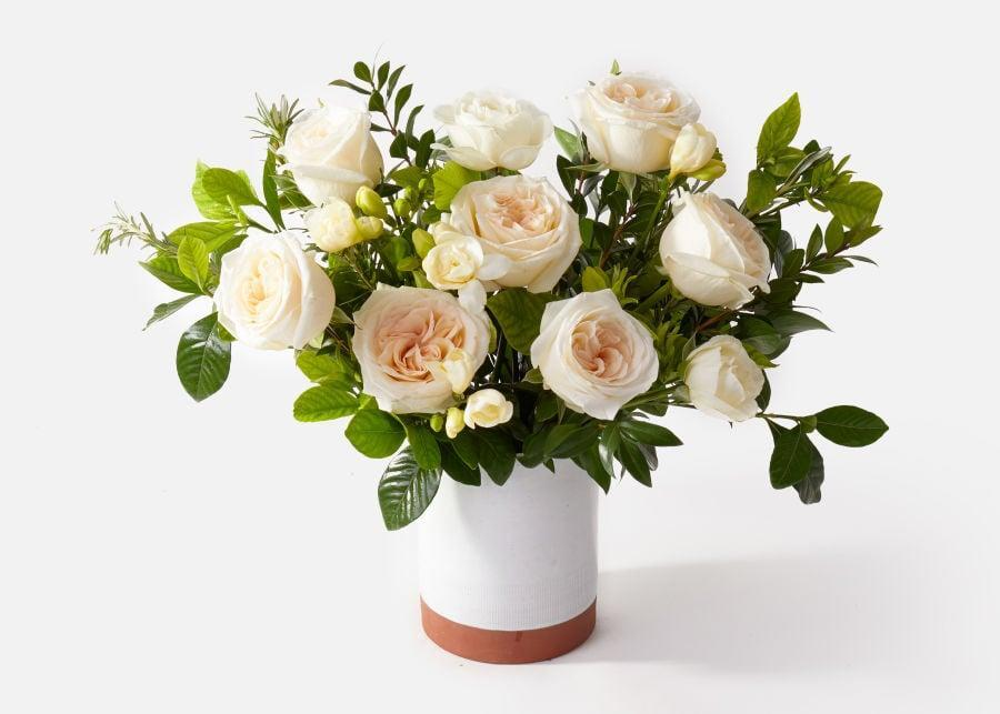 """<p>Mom's home will smell sweet and fresh with the garden roses in <a href=""""https://www.popsugar.com/buy/Muse-Arrangement-569162?p_name=The%20Muse%20Arrangement&retailer=urbanstems.com&pid=569162&price=160&evar1=casa%3Aus&evar9=46127505&evar98=https%3A%2F%2Fwww.popsugar.com%2Fhome%2Fphoto-gallery%2F46127505%2Fimage%2F47428779%2FMuse-Garden-Rose-Arrangement&list1=shopping%2Cgift%20guide%2Cflowers%2Chouse%20plants%2Cplants%2Cmothers%20day%2Cgifts%20for%20women&prop13=api&pdata=1"""" class=""""link rapid-noclick-resp"""" rel=""""nofollow noopener"""" target=""""_blank"""" data-ylk=""""slk:The Muse Arrangement"""">The Muse Arrangement</a> ($160). </p>"""
