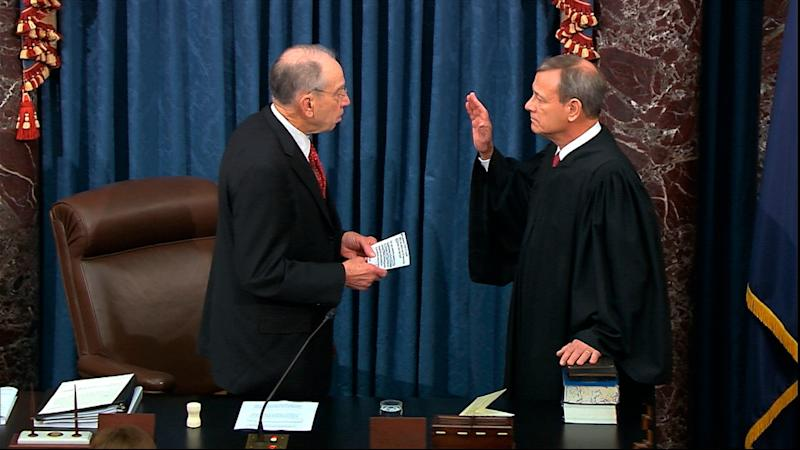In this image from video, President Pro Tempore of the Senate Sen. Chuck Grassley, R-Iowa., swears in Supreme Court Chief Justice John Roberts as the presiding officer for the impeachment trial of President Donald Trump in the Senate at the U.S. Capitol in Washington, Jan. 16, 2020.