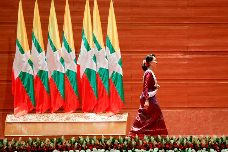 FILE PHOTO: Myanmar State Counselor Aung San Suu Kyi walks off the stage after delivering a speech to the nation on the Rakhine and Rohingya situation, in Naypyitaw