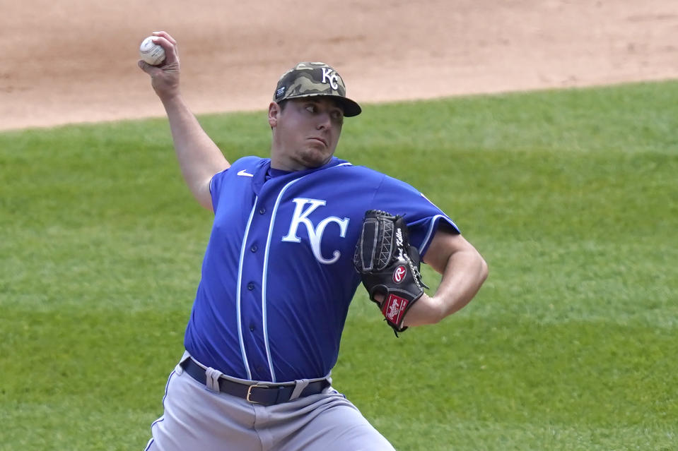 Kansas City Royals starting pitcher Brad Keller delivers in the first inning of the first game of a baseball doubleheader Friday, May 14, 2021, in Chicago. (AP Photo/Charles Rex Arbogast)
