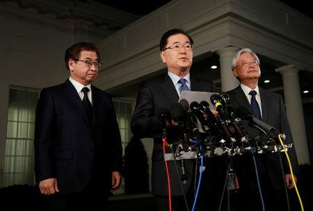 South Korea's National Security Office head Chung Eui-yong, center, and National Intelligence Service chief Suh Hoon, (L), make an announcement about North Korea and the Trump administration outside of the West Wing at the White House in Washington, U.S. March 8, 2018. REUTERS/Leah Millis