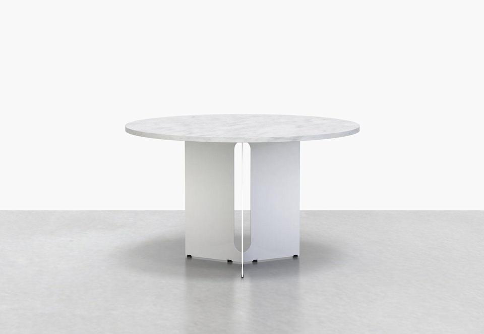"""<p>uhurudesign.com</p><p><strong>$2.00</strong></p><p><a href=""""https://www.uhurudesign.com/collections/tables/products/trilo-round-table-48d"""" rel=""""nofollow noopener"""" target=""""_blank"""" data-ylk=""""slk:Shop Now"""" class=""""link rapid-noclick-resp"""">Shop Now</a></p><p>""""Serve your lobster rolls and Labor Day feast on a brand-new round table from Brooklyn-based Uhuru Design, a low-key studio that is now approaching its 20th decade. This striking piece, with its Carrara marble and sturdy powder-coated steel base is a strong foundation for a big family meal, one where the serving station is as much of a star as the yummy dishes on offer.""""—<em>Erik Maza, Style Features Director</em></p>"""