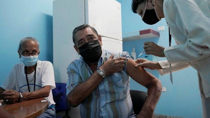 A man is vaccinated in Havana