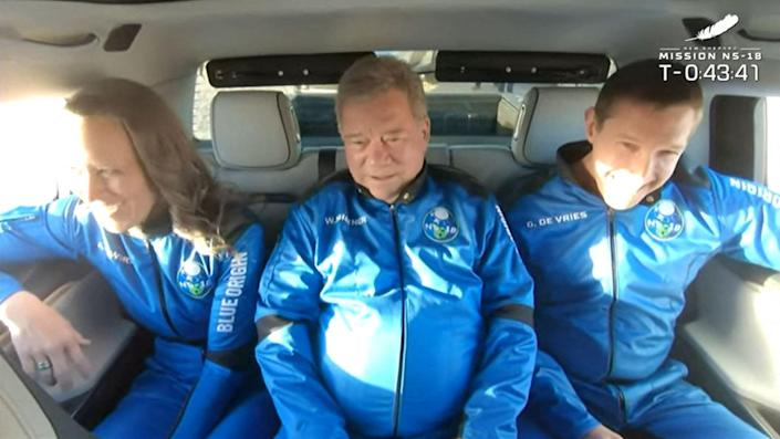 """In this still image taken from a Blue Origin video, New Shepard NS-18 mission crew members (L-R) Blue Origins Vice President of Mission & Flight Operations, Audrey Powers; """"Star Trek"""" actor, William Shatner and Medidata Solutions Co-Founder, Glen de Vries, ride to the launch pad on Oct. 13, 2021, before lift off from the West Texas region, 25 miles north of Van Horn."""