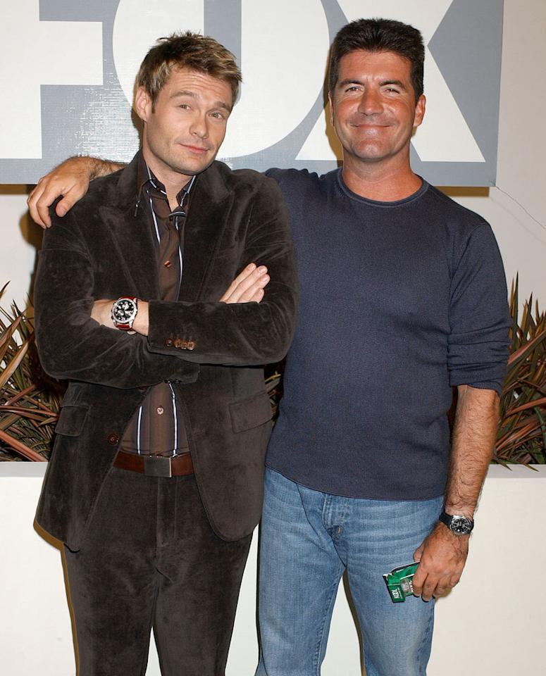 """That's the advantage of wearing the same old thing — here, host Ryan Seacrest looks like he's the one committing the fashion faux pas. The fourth """"<a href=""""/american-idol/show/34934"""">Idol</a>"""" season's a tumultuous one, with two contestants quitting, but 2005 is also the year Carrie Underwood wins. In May, Simon faced Oprah and survives her questions and video clips, like the one with Ryan talking about how Simon's """"T-shirts are too small, they're too tight…The man-boobs — we really have to reduce the size."""" But Simon does admit to one fear: """"I'm turning into Paula…For one moment, I used the word 'proud.'"""" He doesn't have to worry long: Before the year's out, he signs a five-year contract with Fox, making him the richest person on American TV."""