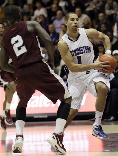 Northwestern forward Drew Crawford, right, drives to the basket against Texas Southern guard Dexter Ellington (2) during the first half of an NCAA college basketball game in Evanston, Ill., on Thursday, Dec. 15, 2011. (AP Photo/Nam Y. Huh)