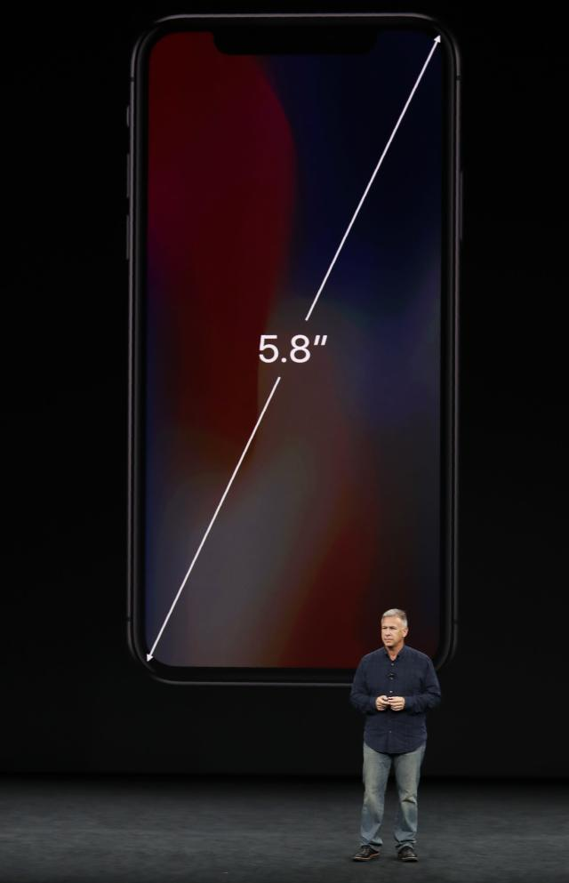 <p>The bezel-less design makes it possible to have a 5.8″ screen in a form factor the same as the iPhone 7. REUTERS/Stephen Lam </p>