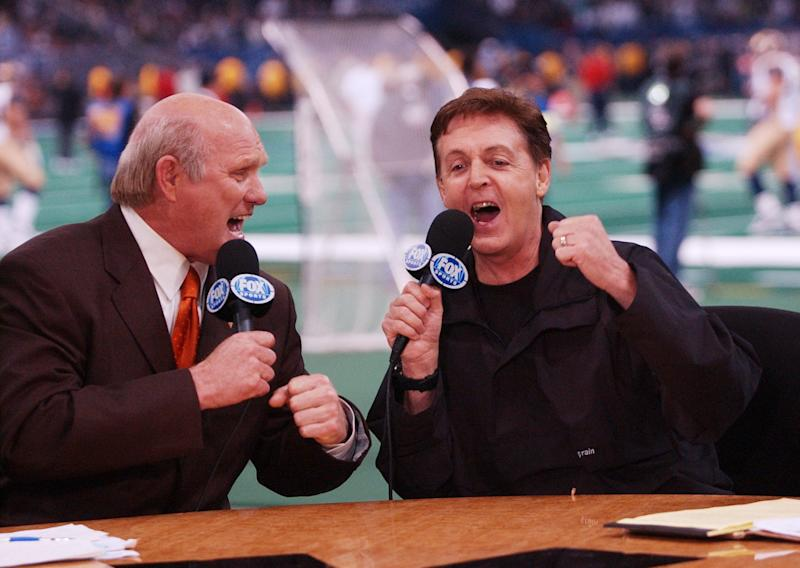 Fox Sports broadcaster Terry Bradshaw and Sir Paul McCartney sing a duet of 'A Hard Day's Night' during the halftime show of Super Bowl XXXVI at the Superdome in New Orleans, Louisiana February 3, 2002.