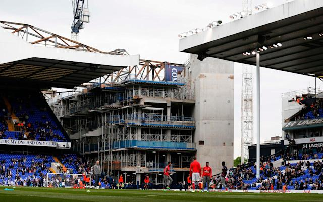 The new stadium can be seen through White Hart Lane - AFP