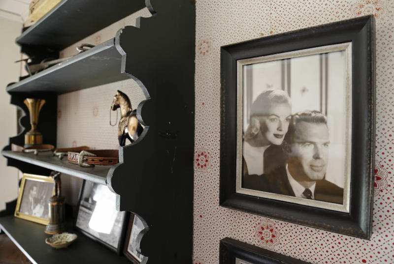 """In this photo taken March 15, 2013, a photograph of actor Fred MacMurray and his actress wife June Haver hangs in an upstairs room of MacMurray's home at the MacMurray Ranch in Healdsburg, Calif. The former cattle ranch, which was purchased in 1941 by the actor in the popular TV series """"My Three Sons,"""" now produces wine and is owned by the Gallo wine family. (AP Photo/Eric Risberg)"""