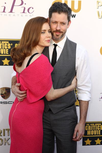 Amy Adams, left, and Darren Le Gallo arrive at the 19th annual Critics' Choice Movie Awards at the Barker Hangar on Thursday, Jan. 16, 2014, in Santa Monica, Calif. (Photo by Matt Sayles/Invision/AP)