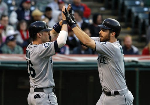 Seattle Mariners' Dustin Ackley, right, is congratulated at home by teammate Brendan Ryan after they both scored on Ackley's two-run home run during the third inning of a baseball game against the Cleveland Indians in Cleveland on Wednesday, May 16, 2012. (AP Photo/Amy Sancetta)