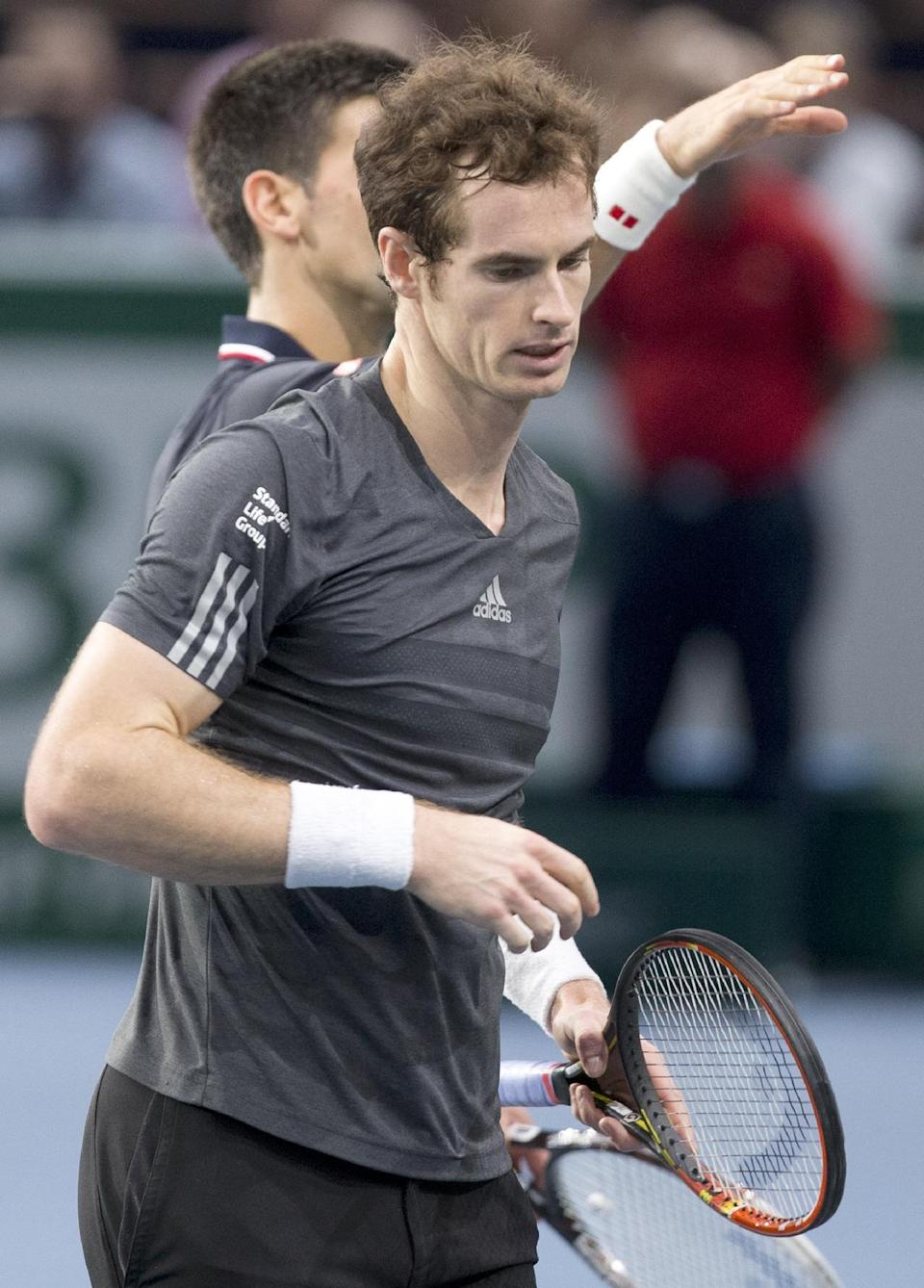Andy Murray of Britain leaves the court after losing a match against to Serbia's Novak Djokovic during their quaterfinal match at the ATP World Tour Masters tennis tournament at Bercy stadium in Paris, France, Friday, Oct. 31, 2014. Djokovic Won the match 7-5, 6-2 .(AP Photo/Jacques Brinon)