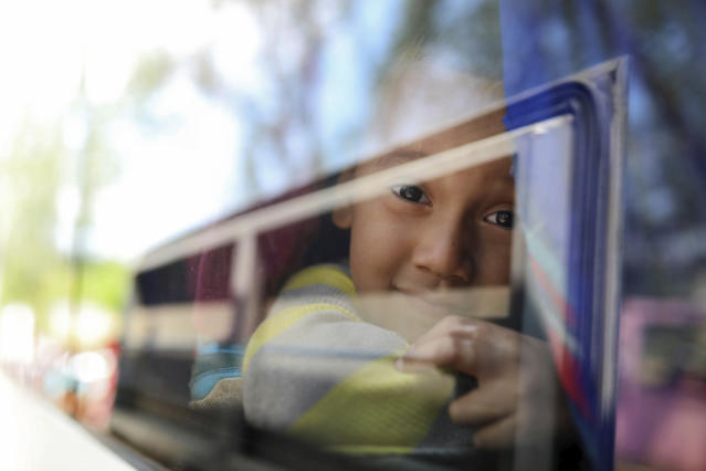 "<p>A young boy peers out the window of the bus that will carry him to Mexico City from the sports club where Central American migrants traveling with the annual ""Stations of the Cross"" caravan had been camping out in Matias Romero, Oaxaca State, Mexico, Thursday, April 5, 2018. (Photo: Felix Marquez/AP) </p>"
