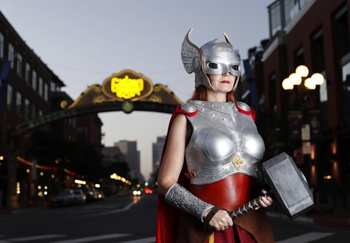 """Colleen Rodriguez as Thor near the archway for the Gaslamp Quarter in downtown San Diego. <span class=""""copyright"""">(K.C. Alfred/The San Diego Union-Tribune)</span>"""