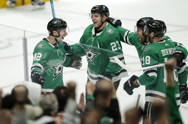 Dallas Stars defenseman Taylor Fedun (42) is congratulated by teammates after scoring a goal during the first period of an NHL hockey game against the Vegas Golden Knights Friday, Dec. 13, 2019, in Dallas. (AP Photo/Brandon Wade)