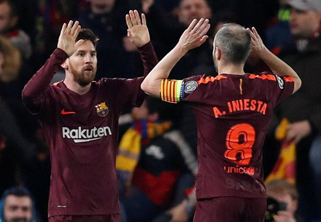 Soccer Football - Champions League Round of 16 First Leg - Chelsea vs FC Barcelona - Stamford Bridge, London, Britain - February 20, 2018 Barcelona's Lionel Messi celebrates scoring their first goal with Andres Iniesta Action Images via Reuters/Matthew Childs