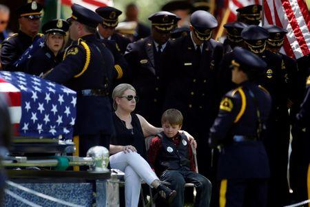 Thousands attend funerals for slain police officers in Dallas