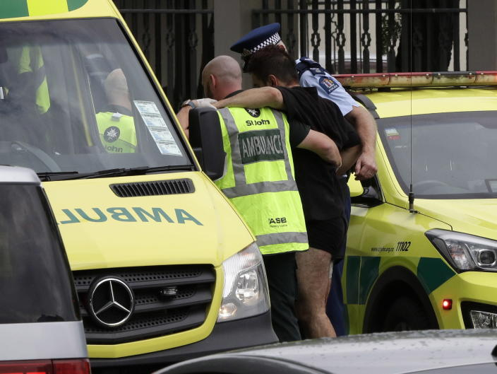 <p>Police and ambulance staff help a wounded man from outside a mosque in central Christchurch, New Zealand. (AP Photo/Mark Baker) </p>