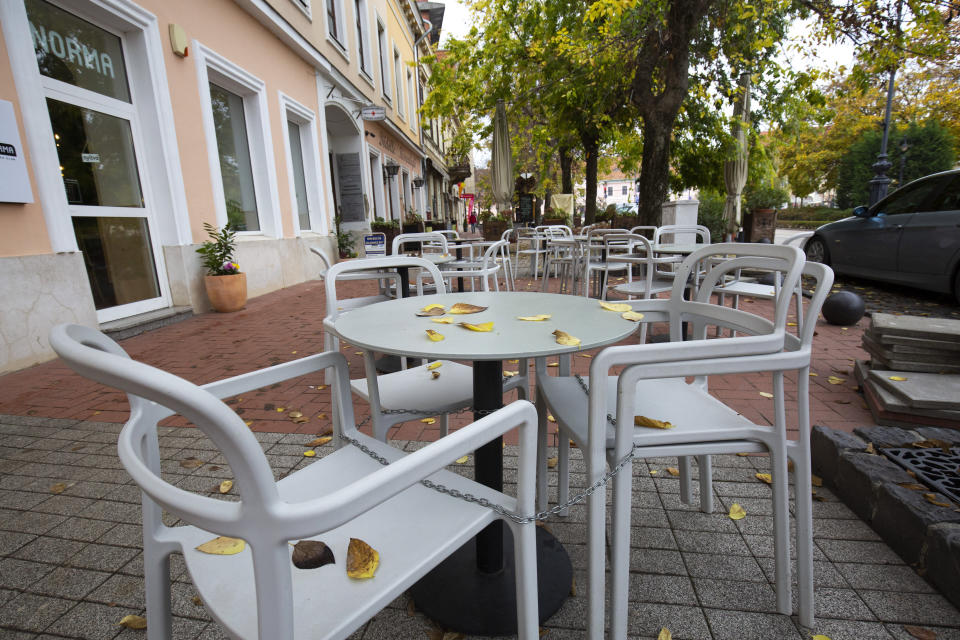 FILE - In this Nov. 11, 2020, file photo, empty seats are seen at a restaurant's terrace in Nagykanizsa, Hungary. The European Union still hasn't completely sorted out its messy post-divorce relationship with Britain — but it has already been plunged into another major crisis. This time the 27-member union is being tested as Poland and Hungary block passage of its budget for the next seven years and an ambitious package aimed at rescuing economies ravaged by the coronavirus pandemic. (Gyorgy Varga/MTI via AP, File)