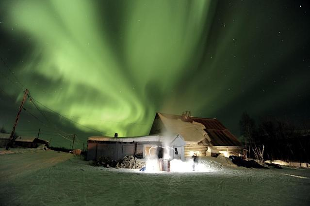 FILE - The aurora borealis, or northern lights, fill the sky above the Takotna, Alaska checkpoint during the Iditarod Trail Sled Dog Race on Wednesday, March 9, 2011. (AP Photo/The Anchorage Daily News, Bob Hallinen, File)