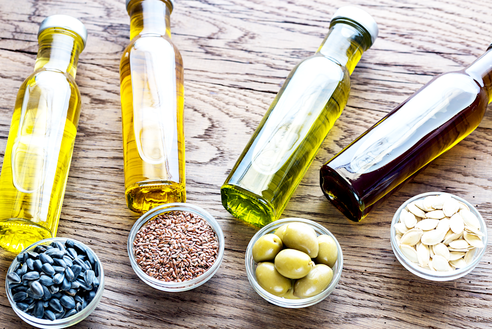 """<p>When it comes to cooking and baking, a common ingredient that you'll find in many recipes is vegetable oil, a neutral oil that's made from extracting the oils from seeds or parts of fruits. But what about when you're fresh out of this staple product at home, or you're simply looking for a healthier alternative? Luckily, there are several easy substitutes for vegetable oil, which include some of the <a href=""""https://www.goodhousekeeping.com/health/diet-nutrition/g32108013/healthiest-cooking-oils/"""" rel=""""nofollow noopener"""" target=""""_blank"""" data-ylk=""""slk:healthiest cooking oils"""" class=""""link rapid-noclick-resp"""">healthiest cooking oils</a> as well as other ingredients that might already be a staple in your kitchen. Here, we've rounded up some of the best substitutes for vegetable oil, including <a href=""""https://www.goodhousekeeping.com/food-products/g4846/top-olive-oil-reviews/"""" rel=""""nofollow noopener"""" target=""""_blank"""" data-ylk=""""slk:olive oil"""" class=""""link rapid-noclick-resp"""">olive oil</a>, <a href=""""https://www.goodhousekeeping.com/health/diet-nutrition/a42975/coconut-oil-benefits/"""" rel=""""nofollow noopener"""" target=""""_blank"""" data-ylk=""""slk:coconut oil"""" class=""""link rapid-noclick-resp"""">coconut oil</a>, butter, and even <a href=""""https://www.goodhousekeeping.com/food-recipes/a28943684/applesauce-recipe/"""" rel=""""nofollow noopener"""" target=""""_blank"""" data-ylk=""""slk:applesauce"""" class=""""link rapid-noclick-resp"""">applesauce</a> and other mashed fruits.</p><p>Whether you're sautéing vegetables, baking a <a href=""""https://www.goodhousekeeping.com/food-recipes/dessert/g757/cake-recipes/"""" rel=""""nofollow noopener"""" target=""""_blank"""" data-ylk=""""slk:delicious cake"""" class=""""link rapid-noclick-resp"""">delicious cake</a>, or even making a <a href=""""https://www.goodhousekeeping.com/food-products/g32188673/best-salad-dressing/"""" rel=""""nofollow noopener"""" target=""""_blank"""" data-ylk=""""slk:salad dressing"""" class=""""link rapid-noclick-resp"""">salad dressing</a> or marinade, these 10 simple and healthy alternatives work great as """
