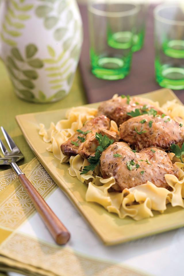 """<p><strong>Recipe:</strong> <a href=""""https://www.southernliving.com/recipes/smothered-chicken""""><strong>Snappy Smothered Chicken</strong></a></p> <p>Southerners will smother anything and this chicken is delightfully so in a savory sauce of paprika, thyme, garlic, butter, and cream of mushroom soup. Spoon over old-school egg noodles.</p>"""