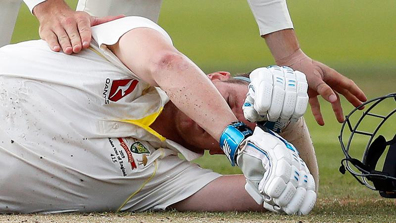 Steve Smith slumped to the turf after being struck by a Jofra Archer bouncer.