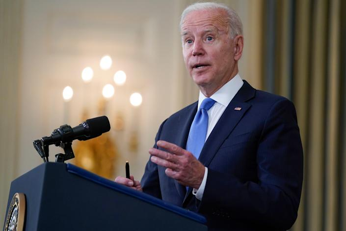 President Joe Biden takes questions from reporters as he speaks about the American Rescue Plan, in the State Dining Room of the White House on Wednesday.
