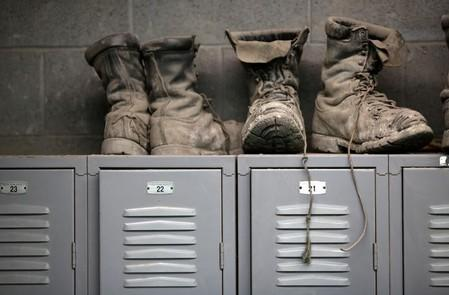 Coal mining boots are shown above miners' lockers before the start of an afternoon shift at a coal mine near Gilbert